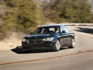 2011-bmw-740i-front-three-quarters-in-motion